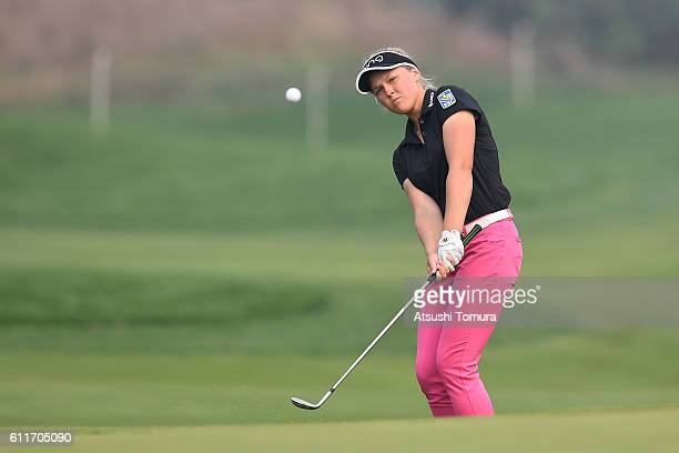 Brooke M Henderson of Canada chips onto the 16th green during the 3rd round of the 2016 Reignwood LPGA Classic on October 1 2016 in Beijing China