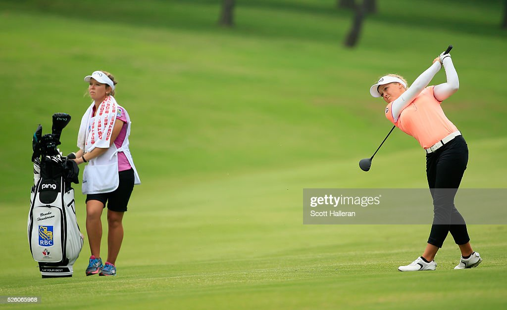 Brooke M. Henderson of Canada hits her second shot on the 18th hole during the second round of the Volunteers of America Texas Shootout at Las Colinas Country Club on April 29, 2016 in Irving, Texas.