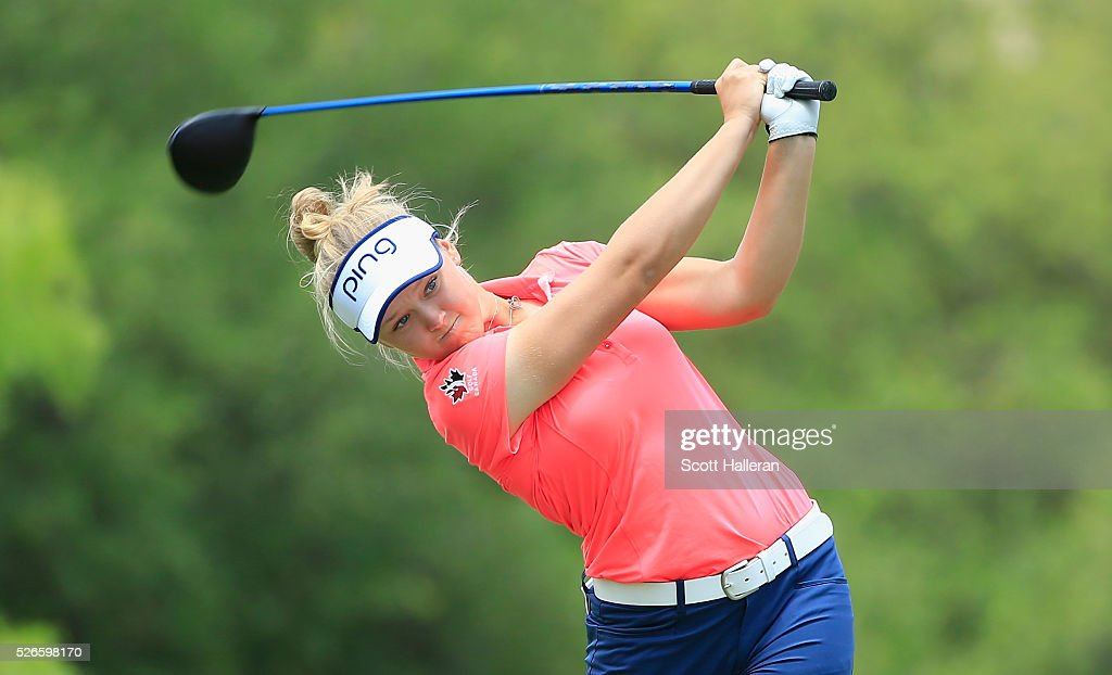 Brooke M. Henderson of Canada hits her tee shot on the third hole during the third round of the Volunteers of America Texas Shootout at Las Colinas Country Club on April 30, 2016 in Irving, Texas.