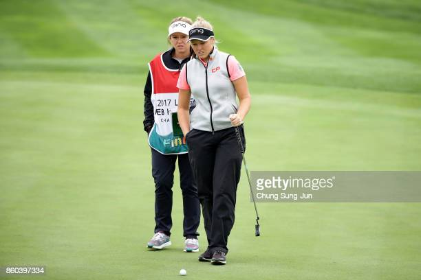 Brooke M Henderson of Canada looks over a green on the 1st green during the first round of the LPGA KEB Hana Bank Championship at the Sky 72 Golf...