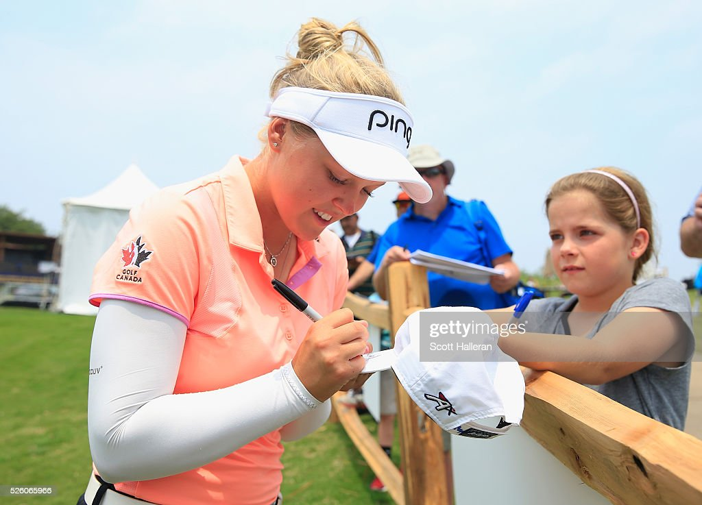 Brooke M. Henderson of Canada signs an autograph for a fan during the second round of the Volunteers of America Texas Shootout at Las Colinas Country Club on April 29, 2016 in Irving, Texas.
