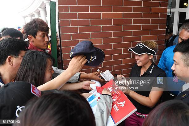Brooke M Henderson of Canada signs autographs for fans during the 3rd round of the 2016 Reignwood LPGA Classic on October 1 2016 in Beijing China