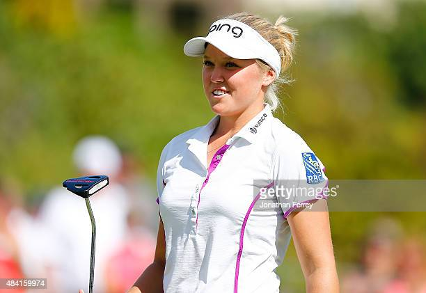Brooke M Henderson of Canada smiles on the 18th hole after shooting 18 under par for the tournament during the third round of the LPGA Cambia...