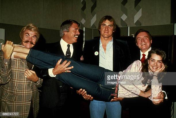 Brooke Shields held up by male celebrities including Rip Taylor circa 1981 in New York City