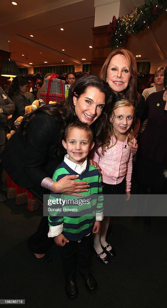 Brooke Shields, Marlo Thomas and Two patients from St. Jude Children's Research Hospital attend The Brooks Brothers Hosts Seventh Annual Holiday Celebration To Benefit St Jude Children's Research Hospital on December 12, 2012 in New York City.