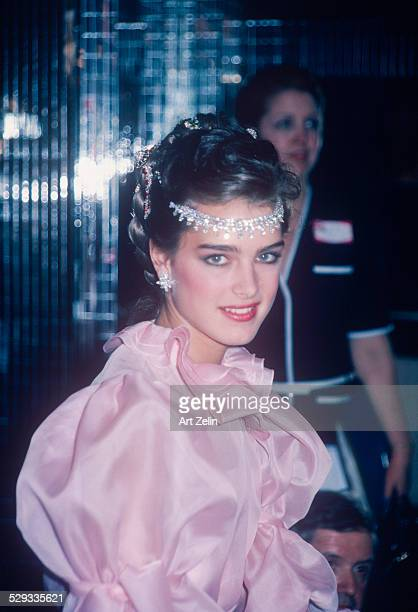 Brooke Shields wearing a pink ruffled dress and jeweled headpiece circa 1970 New York