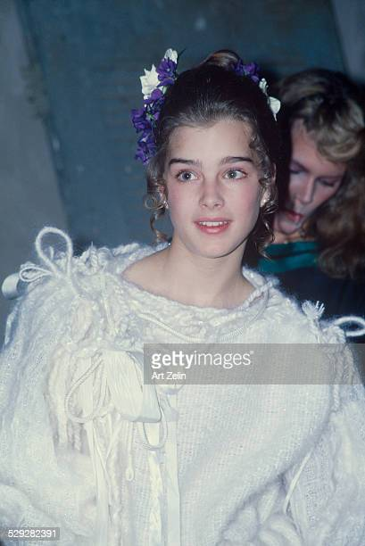 Brooke Shields wearing a white sweater and blue flowers in her hair circa 1970 New York