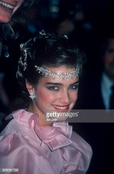 Brooke Shields wearing pink and a jeweled headpiece circa 1970 New York