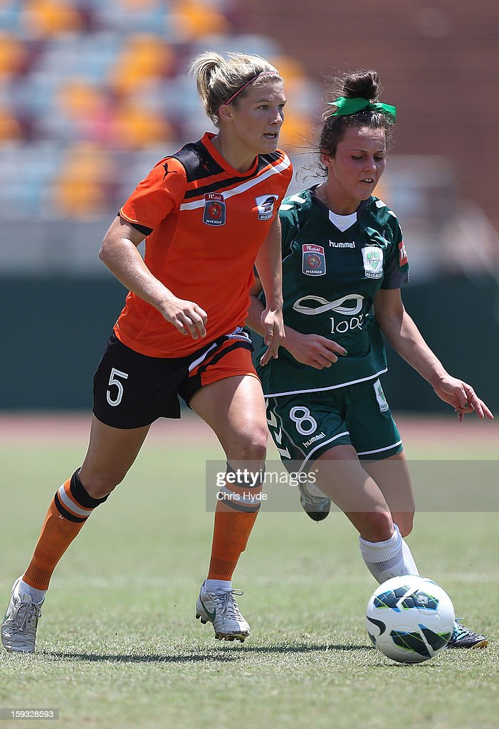 Brooke Spence of the Roar and Hayley Raso of United compete for the ball during the round 12 W-League match between the Brisbane Roar and Canberra United at Queensland Sport and Athletics Centre on January 12, 2013 in Brisbane, Australia.