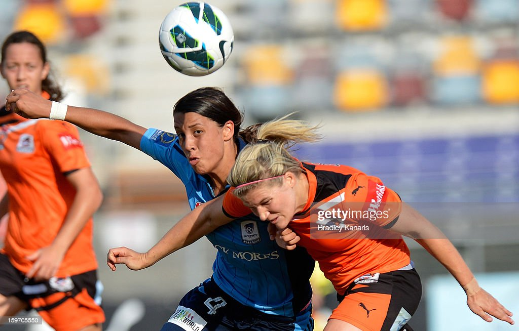 Brooke Spence of the Roar and Samantha Kerr of Sydney challenge for the ball during the W-League Semi Final match between the Brisbane Roar and Sydney FC at Queensland Sport and Athletics Centre on January 19, 2013 in Brisbane, Australia.