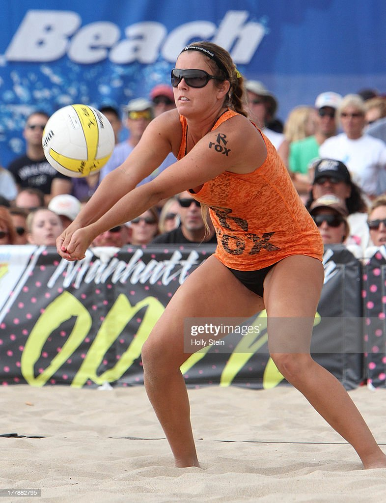 Brooke Sweat digs the ball during the women's finals at the AVP Manhattan Beach Open on August 25, 2013 in Manhattan Beach, California. Sweat and her partner Jennifer Fopma lost to Kerri Walsh Jennings and Whitney Pavlik 22-20, 21-17.