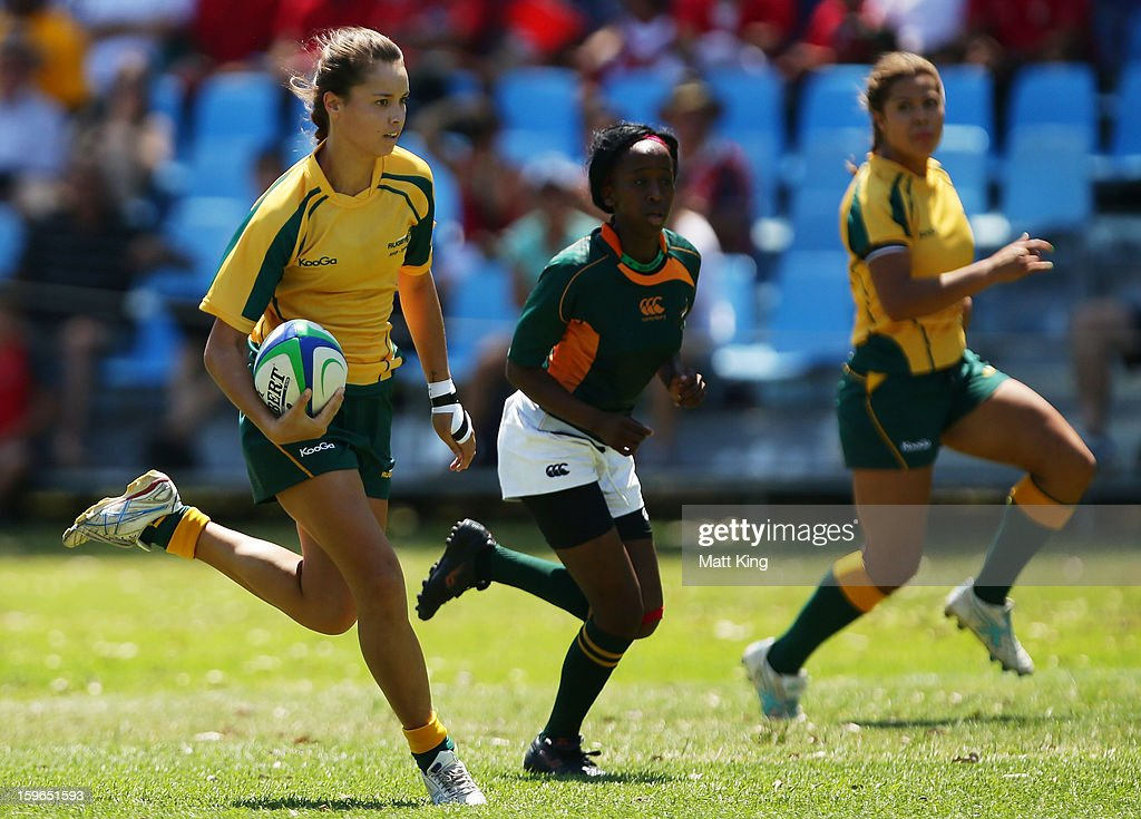 Brooke Walker of Australia makes a break to score a try in the Women's Rugby Sevens during day three of the Australian Youth Olympic Festival at St Ignatius College on January 18, 2013 in Sydney, Australia.