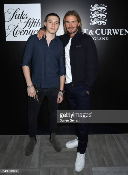 Brooklyn Beckham and David Beckham attends the 'Autumnal British Garden Party' from Kent Curwen England hosted by David Beckham and Creative Director...