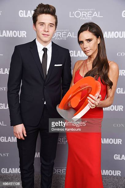Brooklyn Beckham and designer Victoria Beckham pose backstage with her award at the 2015 Glamour Women Of The Year Awards at Carnegie Hall on...