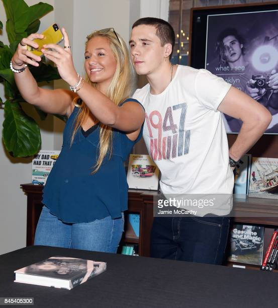 Brooklyn Beckham and guest pose as Brooklyn Beckham signs WHAT I SEE at Rizzoli New York at Rizzoli Bookstore on September 10 2017 in New York City