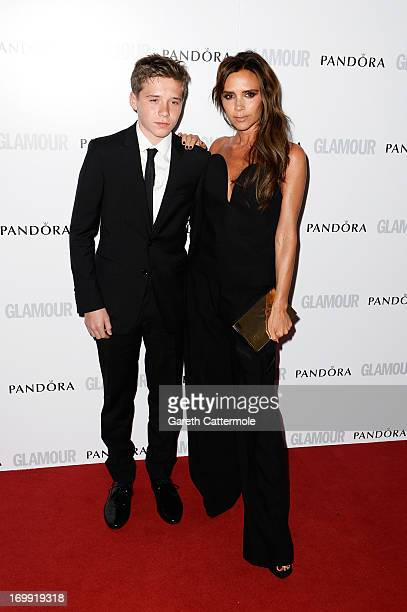 Brooklyn Beckham and Victoria Beckham attend Glamour Women of the Year Awards 2013 at Berkeley Square Gardens on June 4 2013 in London England