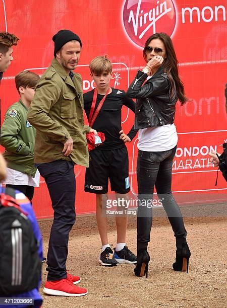 Brooklyn Beckham Cruz Beckham David Beckham and Victoria Beckham congratulate Romeo Beckham after he finished the Childrens Marathon during the...