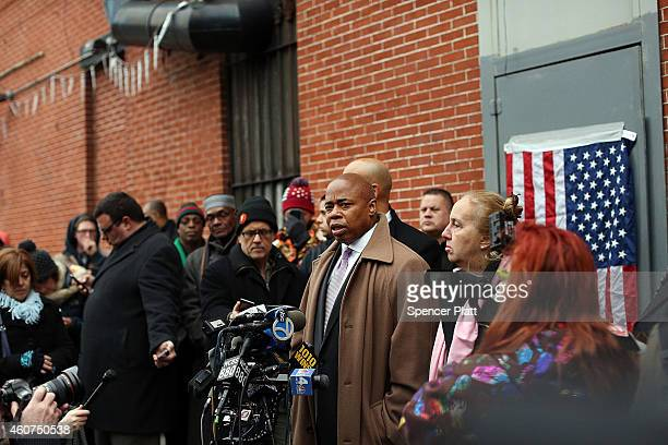 Brooklyn Borough President Eric L Adams speaks near a memorial to the two New York Police Department officers that were shot and killed nearby...