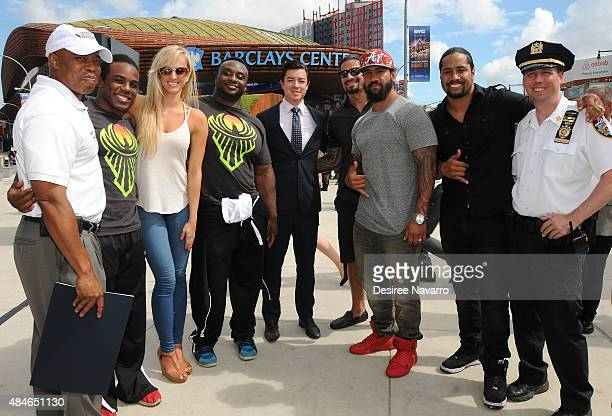 Brooklyn Borough President Eric L Adams WWE Superstars Xavier Woods Summer Rae Big E Vice President of Booking at Barclays Center Keith Sheldon Roman...