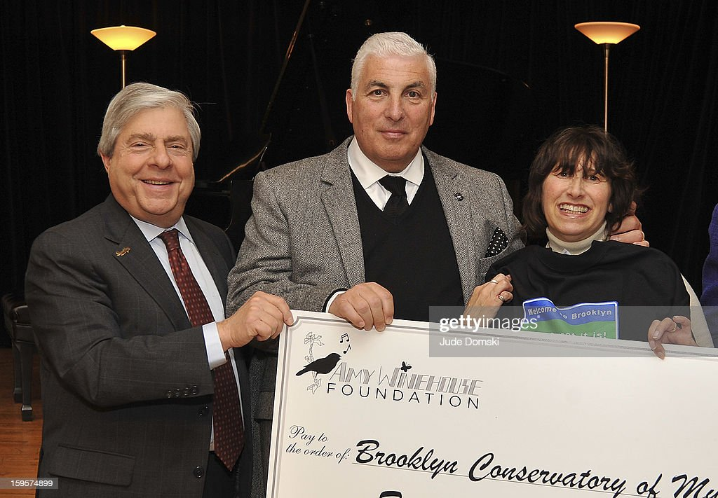 Brooklyn Borough President Marty Markowitz (L) poses with late Singer Amy Winehouse's parents Mitch Winehouse and <a gi-track='captionPersonalityLinkClicked' href=/galleries/search?phrase=Janis+Winehouse&family=editorial&specificpeople=4878411 ng-click='$event.stopPropagation()'>Janis Winehouse</a> at the Amy Winehouse Foundation grant presentation at the Brooklyn Conservatory of Music on January 16, 2013 in the Brooklyn borough of New York City.
