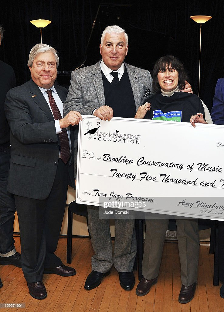 Brooklyn Borough President Marty Markowitz (L) poses with late Singer Amy Winehouse's parents Mitch Winehouse and Janis Winehouse at the Amy Winehouse Foundation grant presentation at the Brooklyn Conservatory of Music on January 16, 2013 in the Brooklyn borough of New York City.