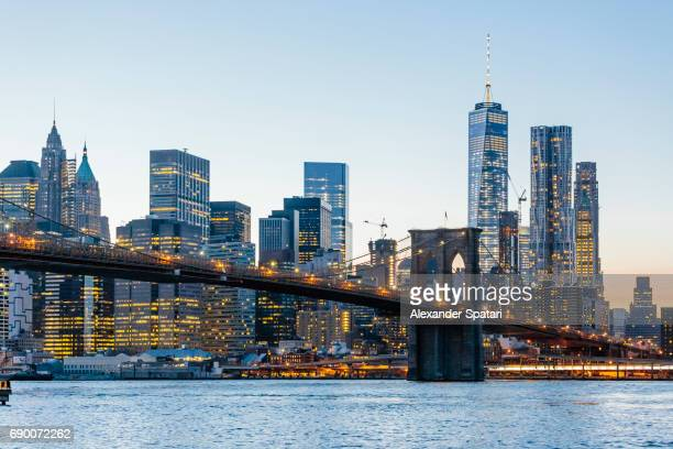Brooklyn Bridge and Manhattan skyline against clear blue sky, New York City, USA