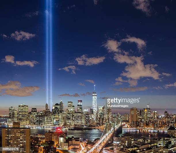 Brooklyn Bridge and Manhattan skyline with The Tribute in Light