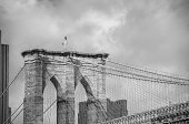 Architectural detail of Brooklyn Bridge connecting Manhattan and Brooklyn in New York City, USA.