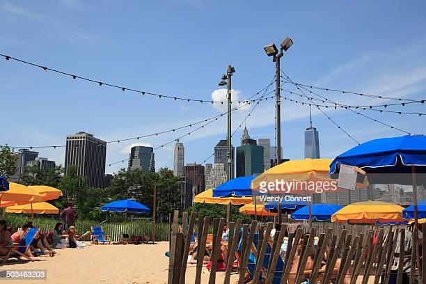 Brooklyn Bridge Park Pop Up Beach adjacent to Pop Up Pool with Manhattan skyline in background Brooklyn New York City USA