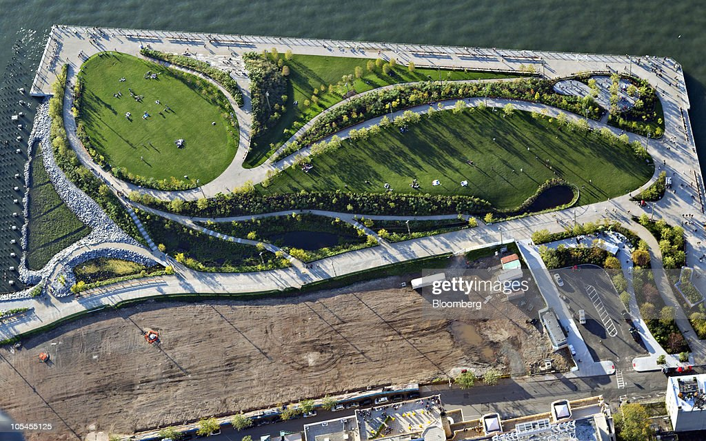 Brooklyn Bridge Park stands next to the East River in this aerial photograph taken over New York US on Saturday Oct 2 2010 New York City sold $775...