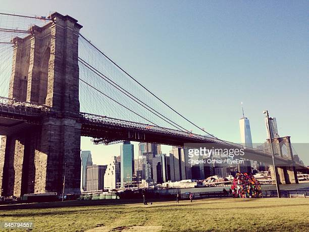 Brooklyn Bridge With One World Trade Center In Background Against Clear Sky