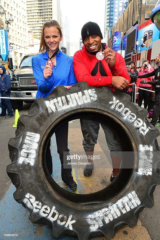 Brooklyn Decker and Tiki Barber tackle The Reebok Spartan Race Times Square Challenge in Times Square on January 17, 2013 in New York City.