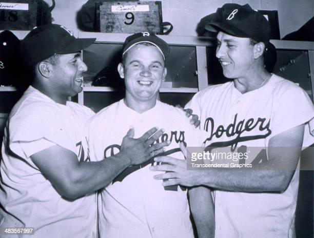 Brooklyn Dodger catcher Roy Campanella left and Gil Hodges right give Don Zimmer a thumbs up after a game in 1953 in Ebbets Field in Brooklyn New York