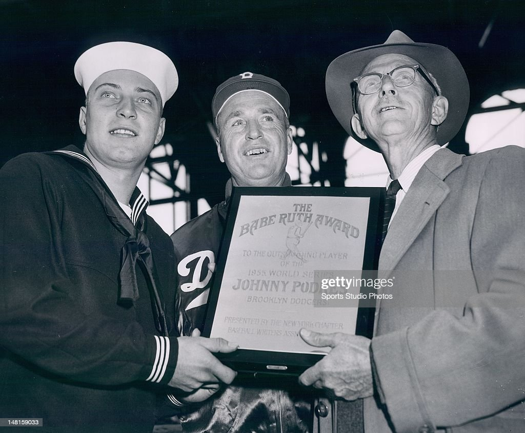 Brooklyn Dodger Johnny Podres receives the Branch Rickey Award from Roscoe McGowan and Brooklyn Dodgers Manager Walt Alston.