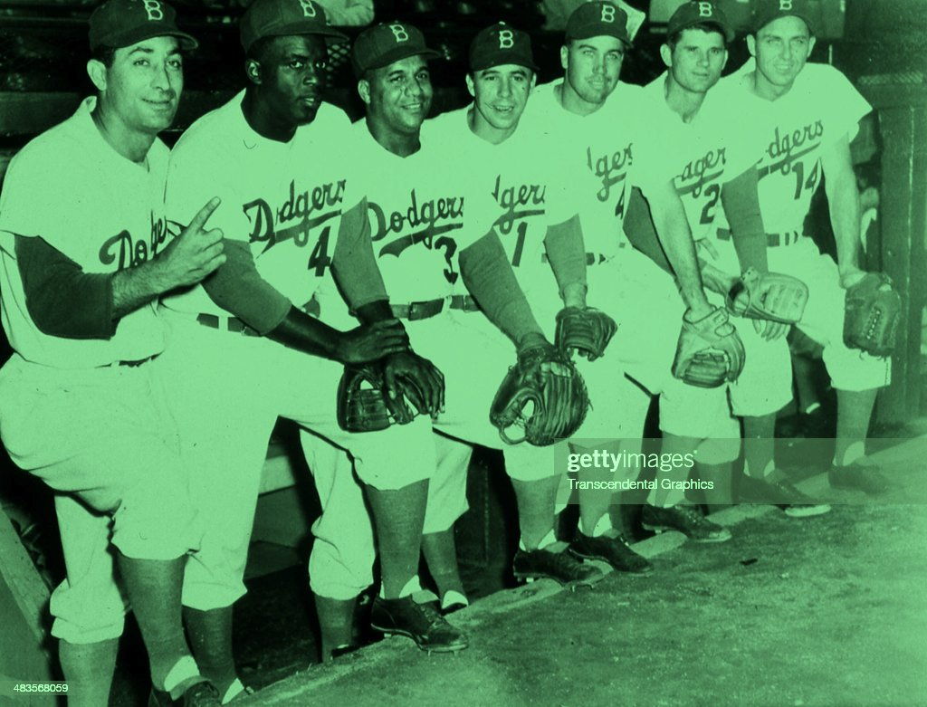 Brooklyn Dodger stars line up on the dugout steps before a game in 1955 in Ebbets Field in Brooklyn New York they are Carl Furillo Jackie Robinson...