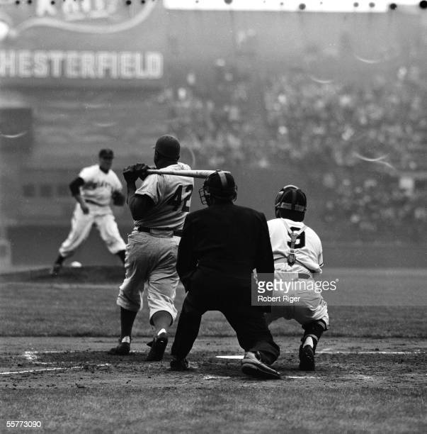 Brooklyn Dodgers batter Jackie Robinson swings at a pitch thrown by New York Giants pitcher Sal Maglie during a game at the Polo Grounds New York New...