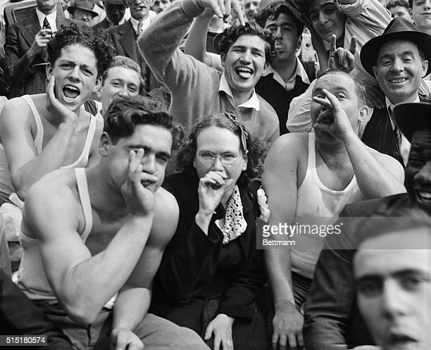 Brooklyn Dodgers fans give their own inimitable version of the Bronx 'cheer' at Yankee Stadium where the Dodgers clashed in the first game of the...