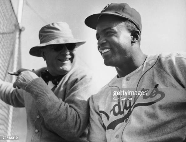 Brooklyn Dodgers President Branch Rickey talking to his second sacker Jackie Robinson at a team training camp in Vero Beach Florida 17th March 1949