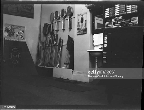 interior of Lenox Sport Shop 767 Flatbush Avenue Close angle on Radiola advertisement tennis rackets and golf clubs on display New York New York late...