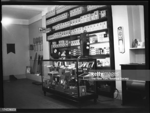 interior of Lenox Sport Shop 767 Flatbush Avenue Light bulbs tennis rackets golf clubs on display New York New York late 19th or early 20th century