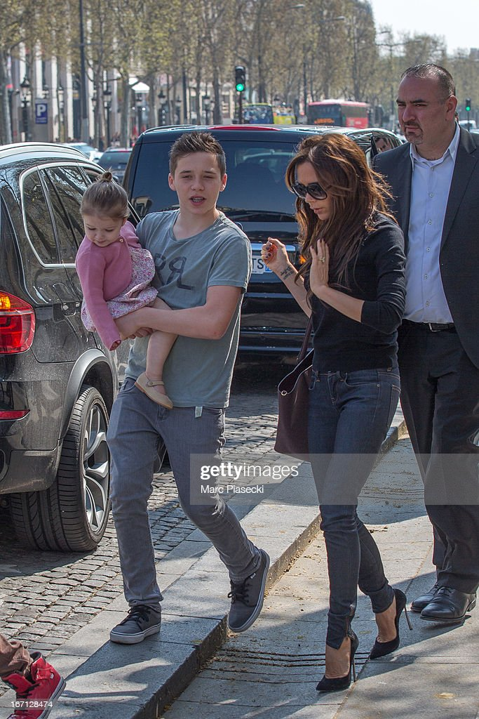 Brooklyn Joseph Beckham with Harper Seven Beckham and <a gi-track='captionPersonalityLinkClicked' href=/galleries/search?phrase=Victoria+Beckham&family=editorial&specificpeople=161100 ng-click='$event.stopPropagation()'>Victoria Beckham</a> are seen leaving the 'NIKE' store on the Champs-Elysees Avenue on April 21, 2013 in Paris, France.