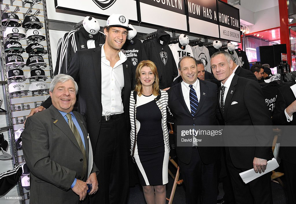 Brooklyn Mayor, Marty Markowitz, Brook Lopez, Irina Pavlova, President, Onexim Sports and Entertainment, Bruce Ratner, Principal Owner and Brett Yormack of the Brooklyn Nets poses for a photo during the unveiling of the new logo of the Brooklyn Nets at a press conference on April 30, 2012 at a Modell's Store in Brooklyn, New York.