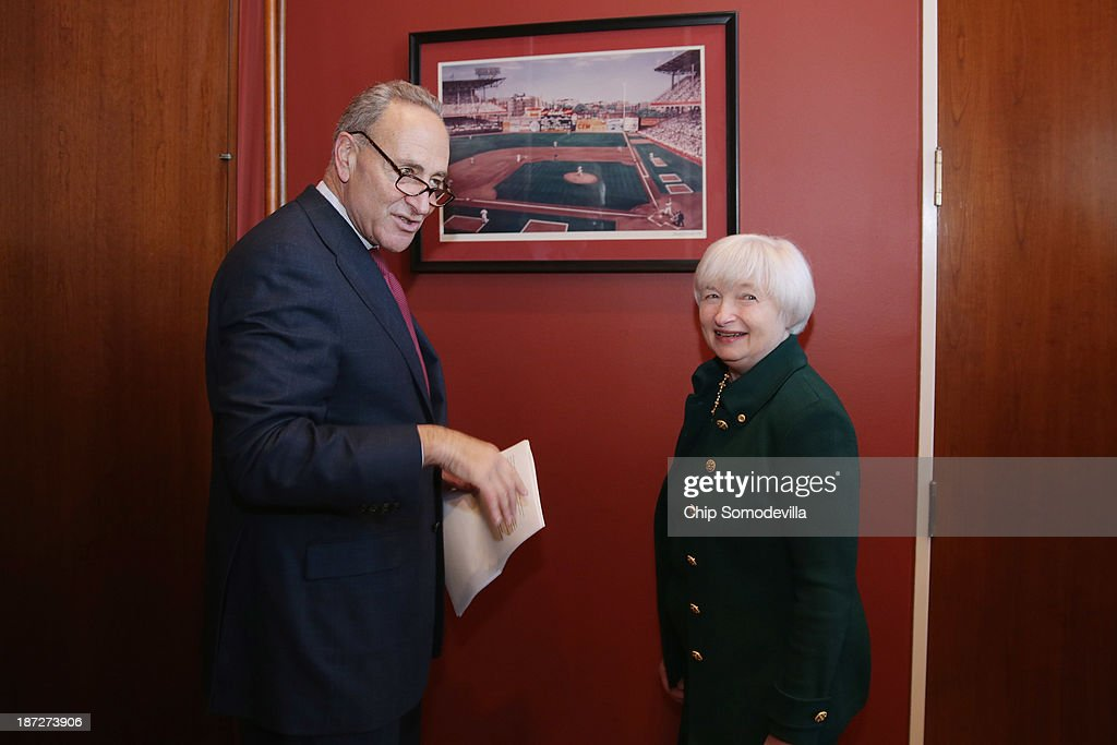 Brooklyn natives, Federal Reserve Board of Governors Vice Chair <a gi-track='captionPersonalityLinkClicked' href=/galleries/search?phrase=Janet+Yellen&family=editorial&specificpeople=2731344 ng-click='$event.stopPropagation()'>Janet Yellen</a> (R) and U.S. Sen. <a gi-track='captionPersonalityLinkClicked' href=/galleries/search?phrase=Charles+Schumer&family=editorial&specificpeople=171249 ng-click='$event.stopPropagation()'>Charles Schumer</a> (D-NY) look at a photograph of Ebbets Field haning in his office in the Hart Senate Office Building November 7, 2013 in Washington, DC. Yellen has been making the rounds on Capitol Hill and meeting with senators since she was nominated October 9 by President Barack Obama to replace outgoing Fed Chairman Ben Bernanke.