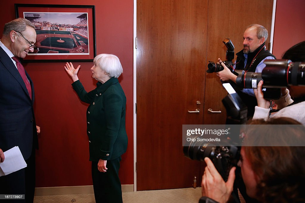Brooklyn natives, Federal Reserve Board of Governors Vice Chair <a gi-track='captionPersonalityLinkClicked' href=/galleries/search?phrase=Janet+Yellen&family=editorial&specificpeople=2731344 ng-click='$event.stopPropagation()'>Janet Yellen</a> (C) and U.S. Sen. <a gi-track='captionPersonalityLinkClicked' href=/galleries/search?phrase=Charles+Schumer&family=editorial&specificpeople=171249 ng-click='$event.stopPropagation()'>Charles Schumer</a> (D-NY) (L) look at a photograph of Ebbets Field as news photographers make their photo in his office in the Hart Senate Office Building November 7, 2013 in Washington, DC. Yellen has been making the rounds on Capitol Hill and meeting with senators since she was nominated October 9 by President Barack Obama to replace outgoing Fed Chairman Ben Bernanke.