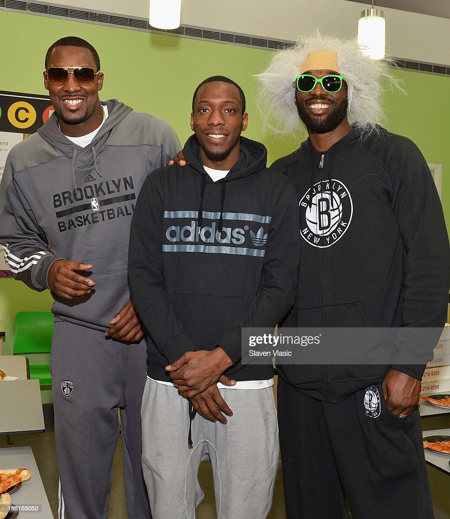 Brooklyn Nets' <a gi-track='captionPersonalityLinkClicked' href=/galleries/search?phrase=Andray+Blatche&family=editorial&specificpeople=4282797 ng-click='$event.stopPropagation()'>Andray Blatche</a>, <a gi-track='captionPersonalityLinkClicked' href=/galleries/search?phrase=Tyshawn+Taylor&family=editorial&specificpeople=5619738 ng-click='$event.stopPropagation()'>Tyshawn Taylor</a> and <a gi-track='captionPersonalityLinkClicked' href=/galleries/search?phrase=Reggie+Evans&family=editorial&specificpeople=202254 ng-click='$event.stopPropagation()'>Reggie Evans</a> host a Halloween Monster Mash for 50 kids at The Brooklyn Children's Museum on October 28, 2013 in New York City.