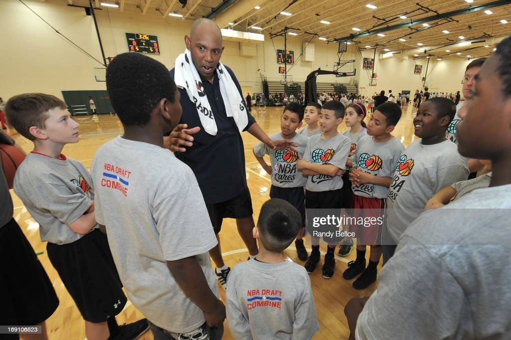 Brooklyn Nets Assistant Coach <a gi-track='captionPersonalityLinkClicked' href=/galleries/search?phrase=Popeye+Jones&family=editorial&specificpeople=224032 ng-click='$event.stopPropagation()'>Popeye Jones</a> talks with participants during a NBA Cares Basketball Clinic as part of the 2013 NBA Draft Combine on May 18, 2013 at Quest Multiplex in Chicago, Illinois.