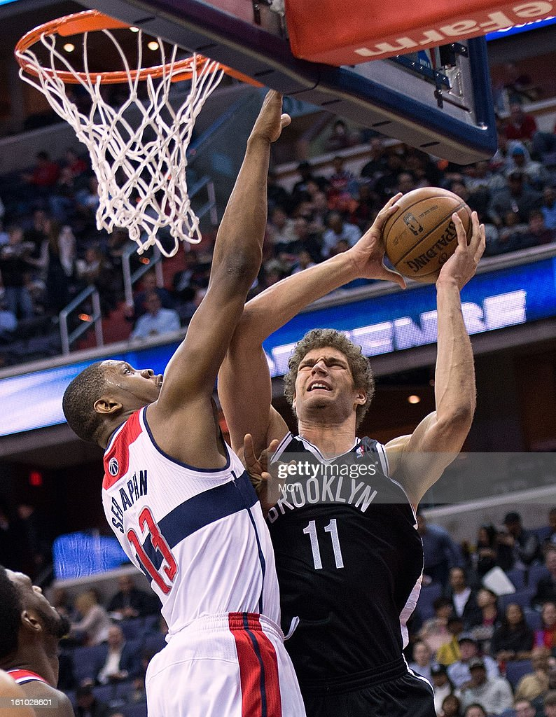 Brooklyn Nets center Brook Lopez (11) is fouled by Washington Wizards power forward Kevin Seraphin (13) during the first half of their game played at the Verizon Center in Washington, D.C., Friday, February 8, 2013.
