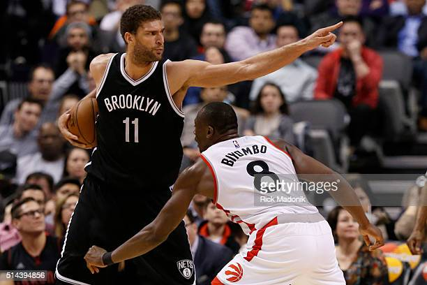 Brooklyn Nets center Brook Lopez points to the corner as he prepares to work the baseline against Toronto Raptors center Bismack Biyombo Toronto...