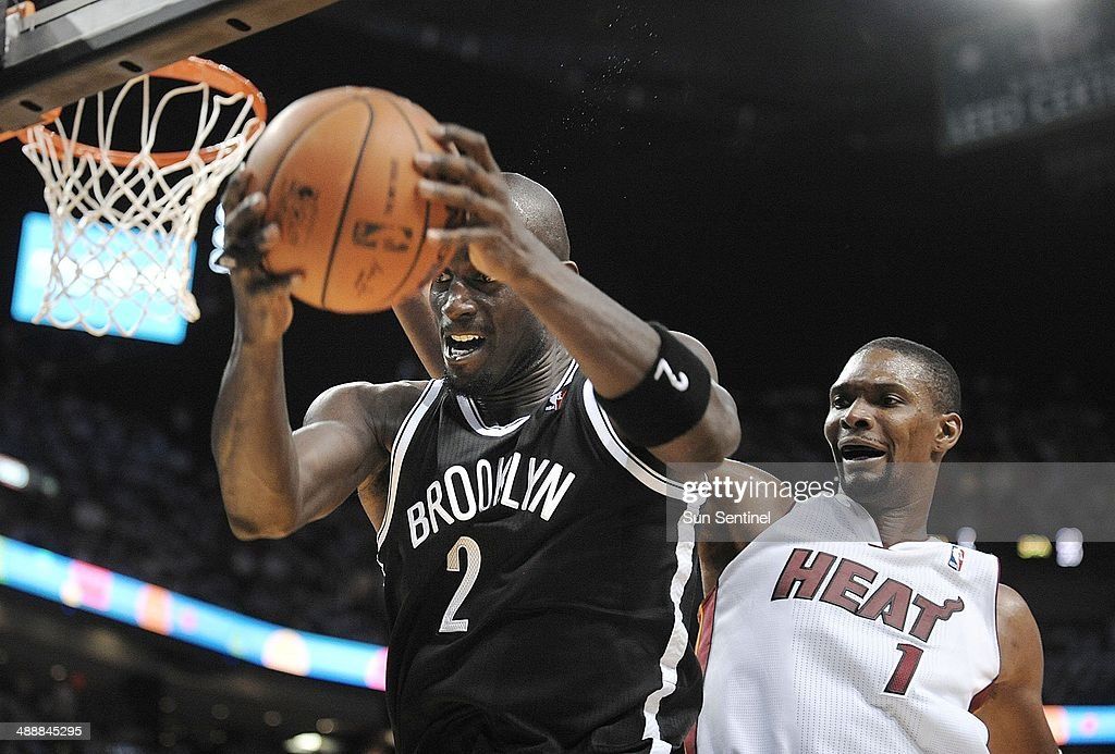 Brooklyn Nets center Kevin Garnett grabs the ball in front of Miami Heat forward Chris Bosh during the fourth quarter in Game 2 of Eastern Conference semifinals on Thursday, May 8, 2014, in Miami.