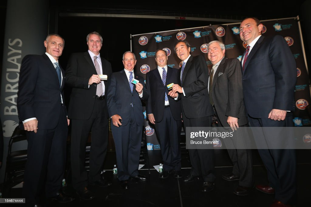 Brooklyn Nets CEO Brett Yormark, New York Islanders general manager Garth Snow, Mayor Michael Bloomberg, Brooklyn Nets owner Bruce Ratner, Islanders owner Charles Wang, Brooklyn Borough President Marty Markowitz and NHL commissioner Gary Bettman gather to announce the New York Islanders move to Brooklyn in 2015 at the Barclays Center on October 24, 2012 in the Brooklyn borough of New York City.